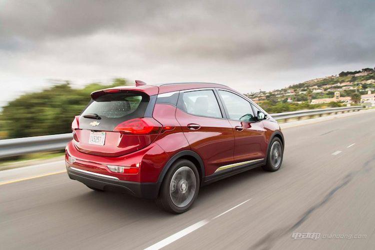2017-Chevrolet-Bolt-EV-Premier-rear-three-quarter-in-motion