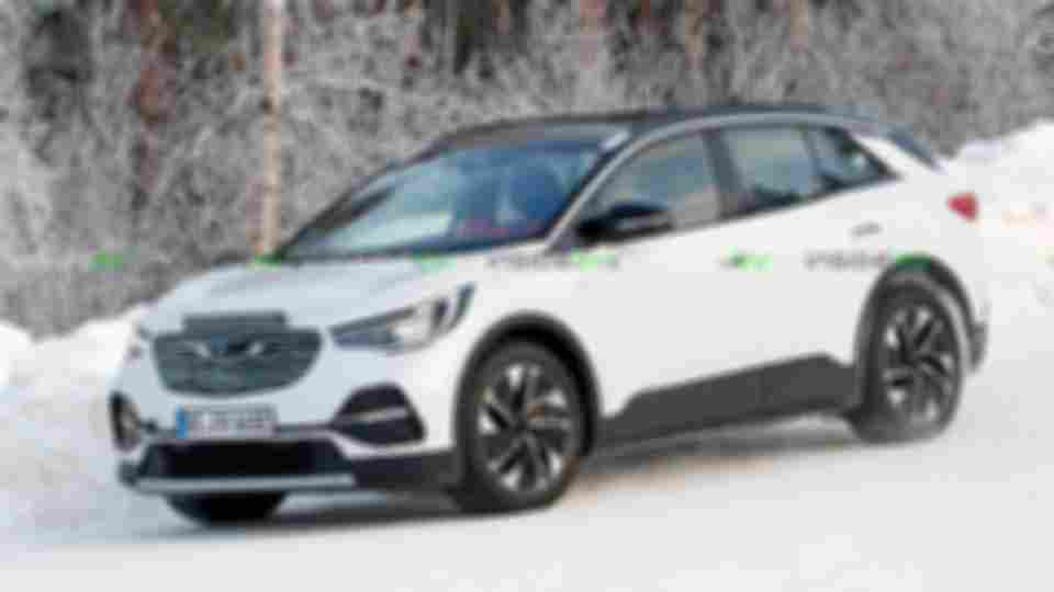 volkswagen-id.4-camouflaged-as-opel---spy-photo
